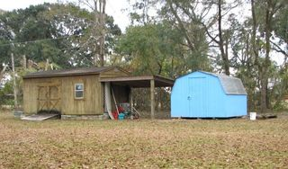Outbuilding/Shed and Storage Shed - Property #1