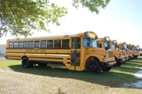 SURPLUS AUCTION • SCHOOL BUSES AND VEHICLES