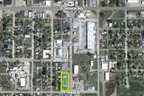 (RUSSELL) ABSOLUTE - 4,276 +/- Sq.Ft. Commercial Building on .41 +/- Acres | Offered Separate & Together