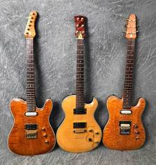 Custom Guitars, Jewelry, Antiques & Old Town Boat