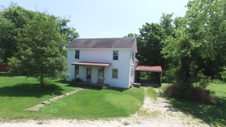 1910 WESTSIDE FARMHOUSE & BARNS ON 10 AC