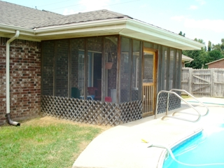 House: Back of house with view of the screened in porch.