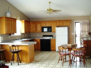 Real Estate: View of kitchen/livingroom, open floorplan with vaulted ceiling.