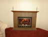 STONE FIREPLACE & HEARTH IN LIVING ROOM: 