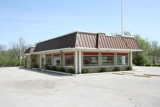 GONE! ABSOLUTE AUCTION - COMMERCIAL REAL ESTATE - BELTON, MISSOURI
