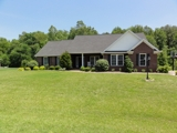 1.5-STORY BRICK HOME W/ 4 BEDROOMS & 3 BATHS ON 1-ACRE LOT