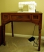 Singer Sewing Machine in cabinet: