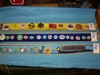 LOT 91 &quot;3 TRAYS OF BUTTONS, BADGES, KEY, RAZOR&quot;: 