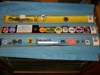 LOT 95  &quot;3 TRAYS OF PINS, BADGES, BOLO TIE, SPIKE, PENDANT&quot;: 