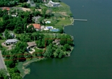 SPECTACULAR 40,000 SQ FT WATERFRONT DREAM LOT - 7BR HOME