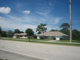2 HOMES SIDE-BY-SITE ON PORT ST. LUCIE BLVD.