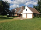 BRICK HOME AND BARNS ON 5 +/- ACRES