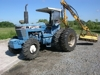 FORD 7710 4 WHEEL DRIVE TRACTOR WITH DITCH MOWER. 2576: