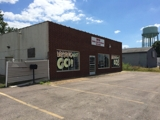ABSOLUTE AUCTION RETAIL BLDG. + 2 LOTS
