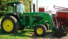 J.D. 4440 with Allied Loader, cab, and new bale spear: