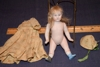 Bisque jointed doll and clothes: