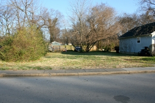 2 Duplexes, Home and 2 Empty Lots
