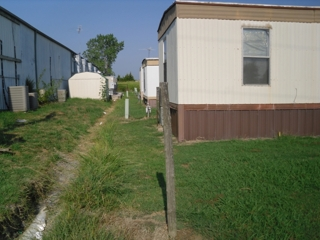 Mobile home park owners blame insolvency on insurers| park, bank