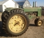 "1952 J.D. ""A"", straight tractor, doesn't use any oil, has fenders, only used to tedder hay:"