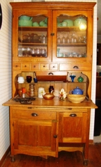 : Antique kitchen cabinet with flour bin and Jadite etc.