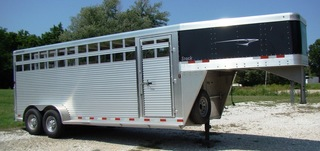 2012 Travalong stock trailer: Like new...only hauled cattle a few times-used to move furniture a couple of times!