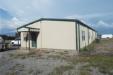 9/9 COMMERCIAL PROPERTY • 9± ACRES PIPE FENCED