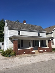 1 1/2 STORY HOME AND DETACHED GARAGE ON 49' x 110' LOT