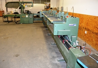 Muller Martini Minuteman Saddle Stitcher with 1511 Conveyor (S/N 947736), 1520 Cover Feeder (S/N 947672), 1522 3-Knife Trimmer, 1509 Wire Stitchers, 1533 6-Pockets (S/N's 947736 & 947339)