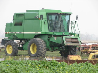 JD CTS harvester on rubber tires