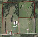 114 acres w/newer 6 bd home, horse training arena, horse barn & more!