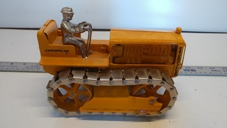 Caterpillar Tractor with Driver
