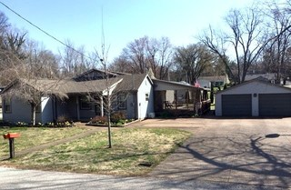 1,902 SF HOME AND DETACHED GARAGES ON 0.25-ACRE LOT