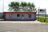 6/6  4± ACRE YARD * OFFICE * 2 METAL SHOP BUILDINGS