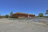 (SE) ABSOLUTE - 6,976 Sq. Ft. Commercial Building on Nearly 2 Acres