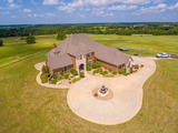 7/20 120± ACRES * BEAUTIFUL CUSTOM HOME * EQUESTRIAN BARN