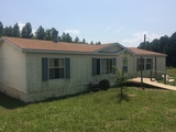 DOUBLEWIDE MOBILE HOME AND METAL GARAGE AUCTION