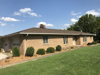1,528 SF HOME, GARAGES, WALK-OUT BASEMENT ON NICE 2.17-ACRE LOT