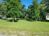 BEAUTIFUL WOODED RIVERFRONT BUILDING LOT