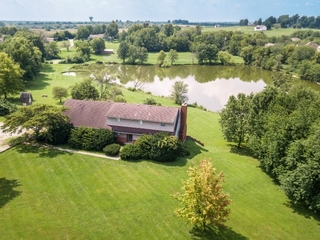 Private Executive Estate: 4 Bedroom Home on 13+ Secluded Acres with Lake | Lee's Summit, MO