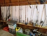 many fishing rods and tackle boxes full of lures: