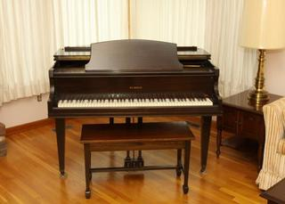 St. Regis baby grand piano
