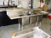 Lot 7 Stainless steel 3 tub kitchen sink w/drain boards, on legs: