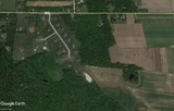 12.82 +/- Wooded Acre Lot in Monroville