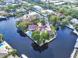 "Real Estate Auction of ""Rare Bay Colony Island Estate Home"""