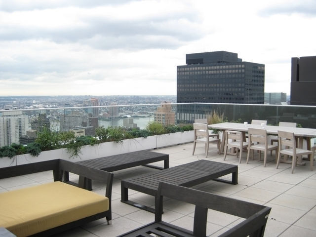 3 000 sq ft luxury condo w 700 sq ft terrace maltz for Bloomberg tower one beacon court