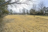 (BEL AIRE) .96 +/- ACRE VACANT LOT ZONED RESIDENTIAL