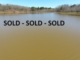 Panola Co. MS - 129.75 +/- ac. Mostly Woods with a 12 +/- ac. Lake - Minutes to Baatesville and Oxford