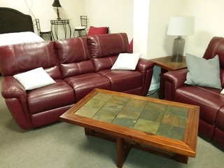 Real Leather Set of Couches. At least one with double recliners. Slate top tables.