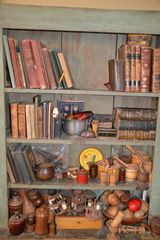 Primitive cupboard w/ books & treenware