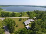 ABSOLUTE AUCTION Lakefront home with 4.24+/- acres on Round Lake, Saratoga County, NY